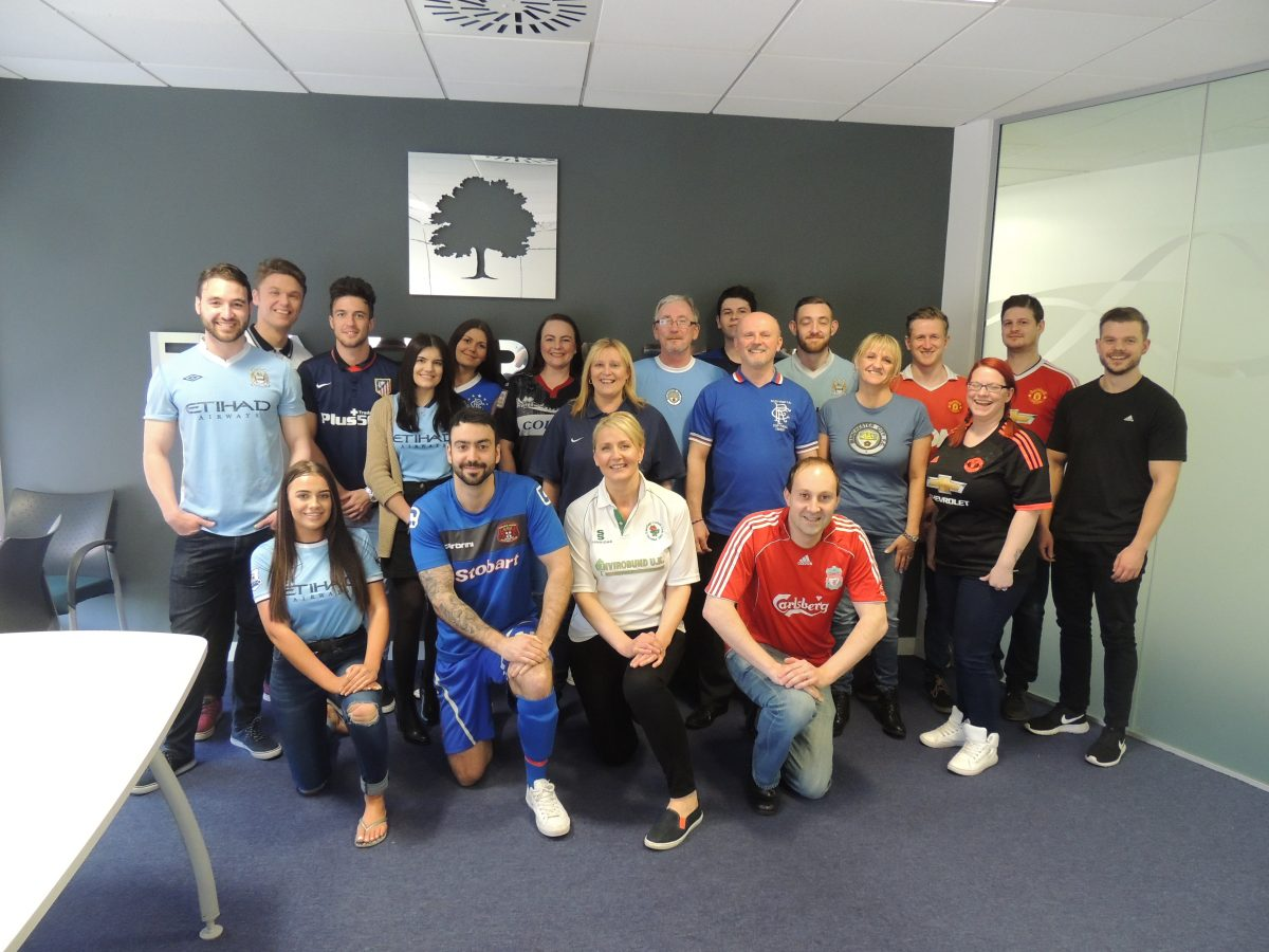 Barratt Manchester office staff wearing sports tops to raise money for The Christie