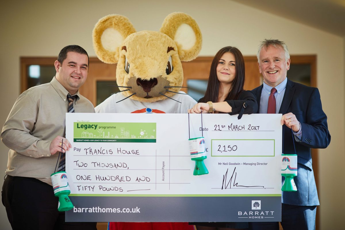 Francis House mascot- Francis Mouse receiving the cheque