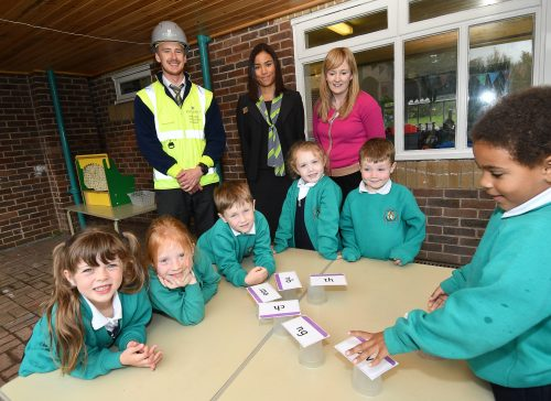 Cottam Primary school pupils with sales and site staff from Cottam Meadow